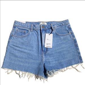 Forever 21 denim shorts with heavily frayed hem.